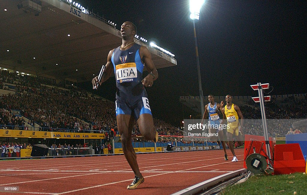 Michael Johnson of the USA crosses the finishing line for the final time as he retires as the USA win the 4 x 400 Metres Relay during the athletics at the ANZ Stadium during the Goodwill Games in Brisbane, Australia. DIGITAL IMAGE MandatoryCredit: Darren England/ALLSPORT