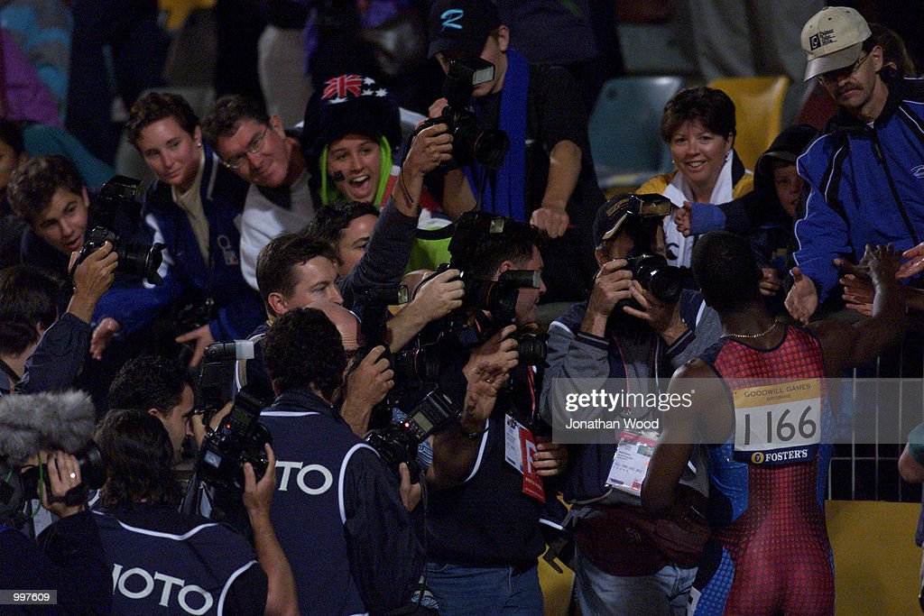 Michael Johnson of the USA is consumed by the press and crowd as he retires as the USA win the 4 x 400 Metres Relay during the athletics at the ANZ Stadium during the Goodwill Games in Brisbane, Australia. DIGITAL IMAGE Mandatory Credit: Jonathan Wood/ALLSPORT