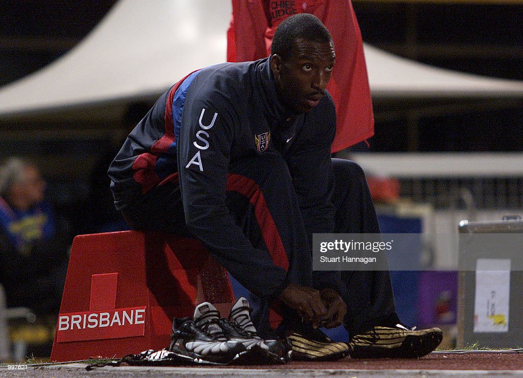 Michael Johnson of the USA laces his running shoes as he retires as the USA win the 4 x 400 Metres Relay during the athletics at the ANZ Stadium during the Goodwill Games in Brisbane, Australia. DIGITAL IMAGE Mandatory Credit: Stuart Hannagan/ALLSPORT