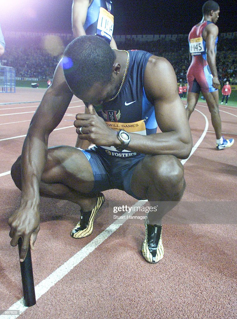 Michael Johnson of the USA prays as he retires as the USA win the 4 x 400 Metres Relay during the athletics at the ANZ Stadium during the Goodwill Games in Brisbane, Australia. DIGITAL IMAGE Mandatory Credit: Stuart Hannagan/ALLSPORT