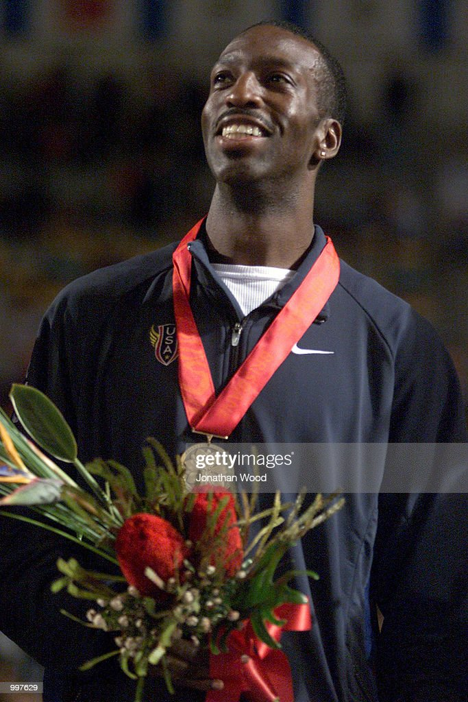 Michael Johnson of the USA smiles after running to victory in the Men's 4 x 400 Metres relay event, held as part of the Goodwill Games at ANZ Stadium, Brisbane, Australia. DIGITAL IMAGE. Mandatory Credit: Jonathan Wood/ALLSPORT