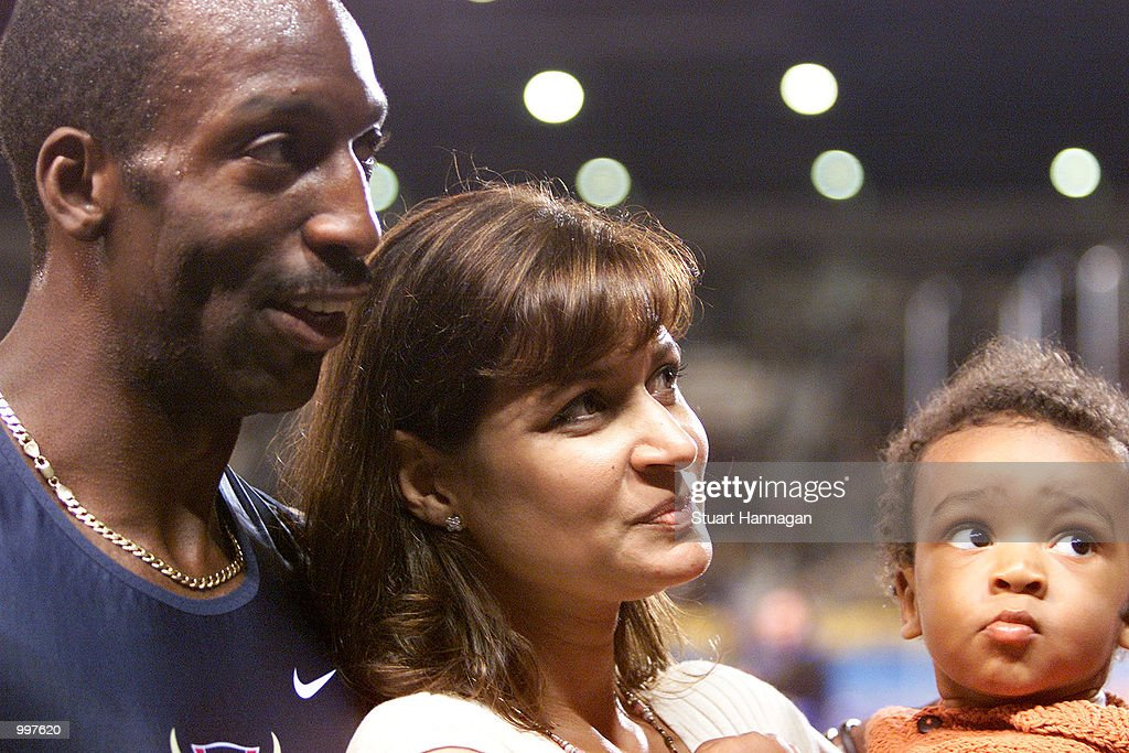 Michael Johnson of the USA speaks to the press with wife Kerri and baby Sebastian as he retires as the USA win the 4 x 400 Metres Relay during the athletics at the ANZ Stadium during the Goodwill Games in Brisbane, Australia. DIGITAL IMAGEMandatory Credit: Stuart Hannagan/ALLSPORT