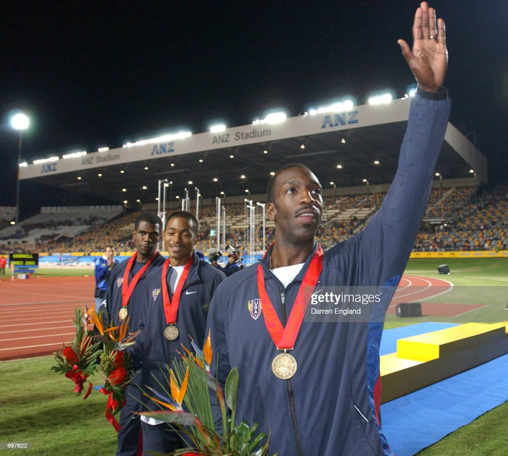 Michael Johnson of the USA waves to the crowd after receiving his Gold medal as he retires as the USA win the 4 x 400 Metres Relay during the athletics at the ANZ Stadium during the Goodwill Games in Brisbane, Australia. DIGITAL IMAGE Mandatory Credit: Darren England/ALLSPORT