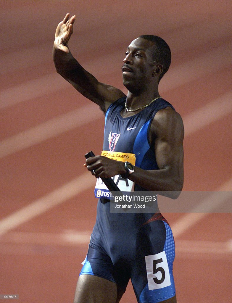 Michael Johnson of the USA waves to the crowd shortly after running to victory in the Men's 4 x 400 Metres relay event, held as part of the Goodwill Games at ANZ Stadium, Brisbane, Australia. DIGITAL IMAGE. Mandatory Credit: Jonathan Wood/ALLSPORT