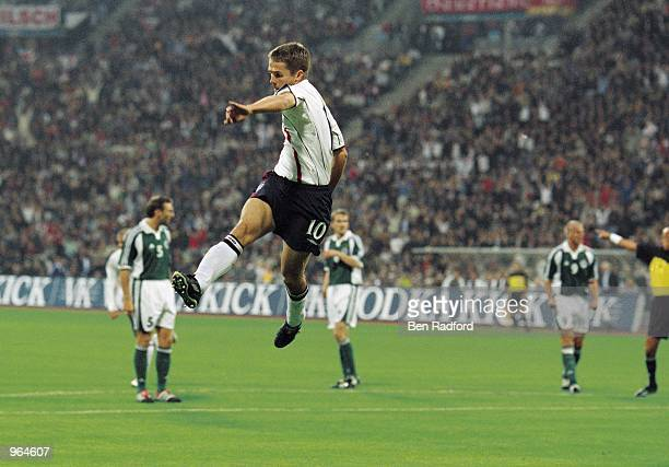Michael Owen of England celebrates after scoring a goal during the FIFA 2002 World Cup Qualifier against Germany played at the Olympic Stadium in...