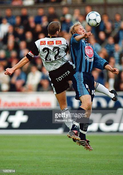 Mikael Dorsin of Djurgarden is challenged by Per Gawilan of Orebro during the Swedish Premier Division game between Djurgarden and Orebro played at...