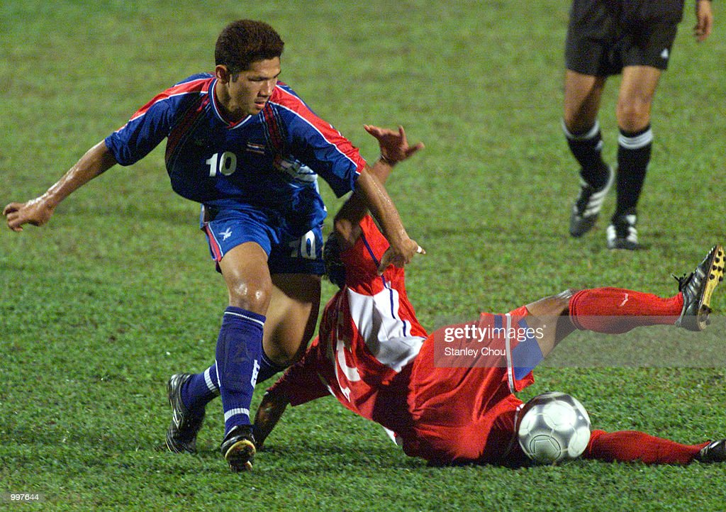 Narongchai Vachiraban of Thailand battles with Oupasong Souliya of Laos in a Group A match held at the MPPJ Stadium, Petaling Jaya, Malaysia during the Under-23 Men Football Tournament of the 21st South East Asian Games. DIGITAL IMAGE. Mandatory Credit: Stanley Chou/ALLSPORT
