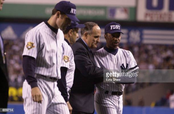New York Mayor Rudy Guliani shakes hands with Willie Randolph of the New York Yankees before the game against the Tampa Bay Devil Rays at Yankee...