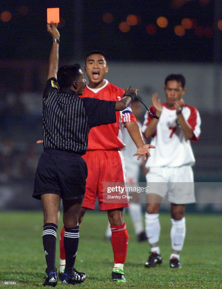 Nguyen Quoc Trung of Vietnam is sent off by the Referee in a Group B match held at the MPPJ Stadium, Petaling Jaya, Malaysia during the Under-23 Men Football Tournament of the 21st South East Asian Games. Indonesia won 1-0. DIGITAL IMAGE. Mandatory Credit: Stanley Chou/ALLSPORT