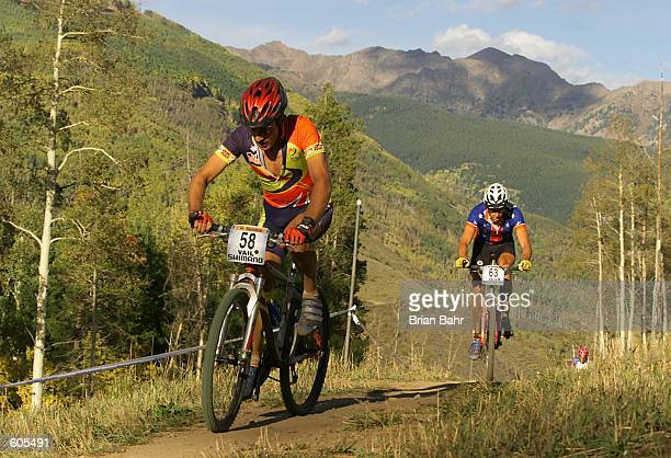Nick Craig of Great Britain and Todd Wells of the USA head up the mountain with the Gore Range in the background during the cross country competition...