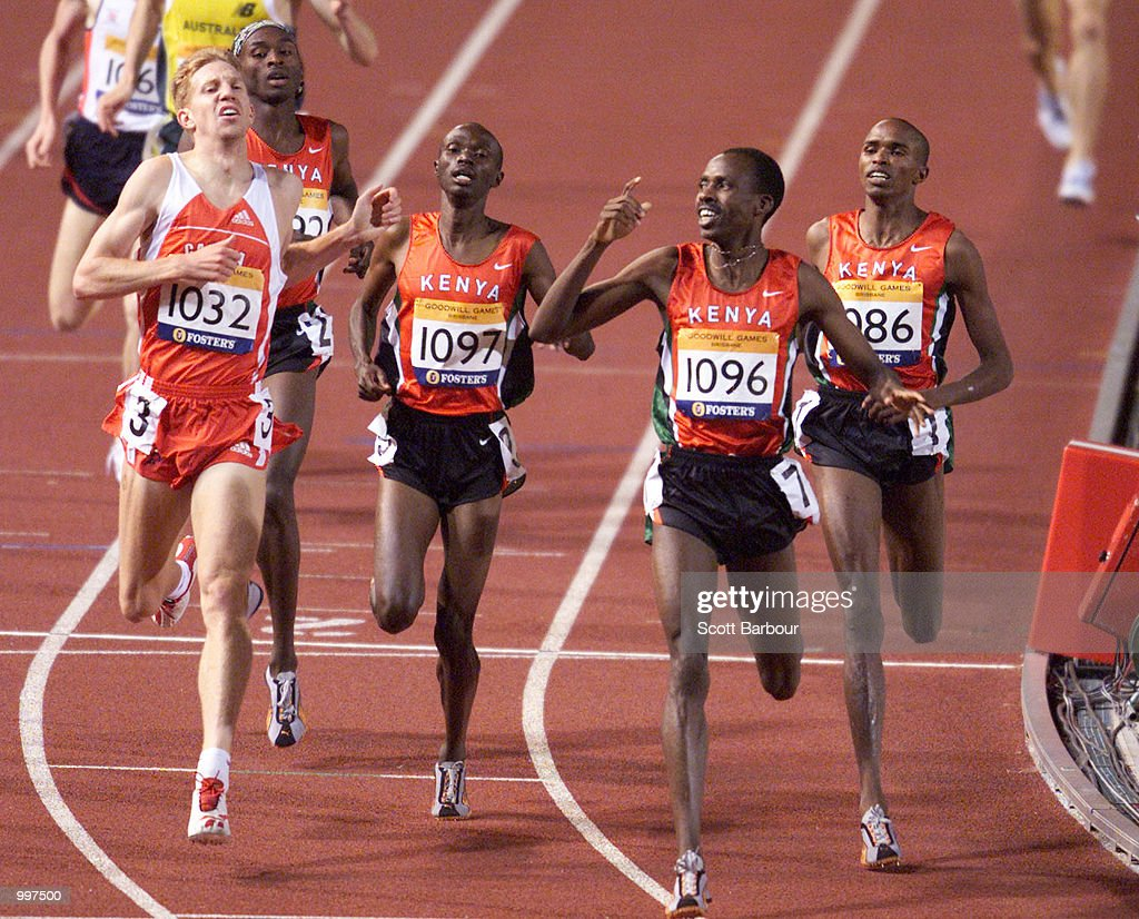 Noah Ngeny of Kenya (second right) wins the Mens Mile in a time of three minutes 56.64 during the athletics at the ANZ Stadium during the Goodwill Games in Brisbane, Australia. DIGITAL IMAGE Mandatory Credit: Scott Barbour/ALLSPORT