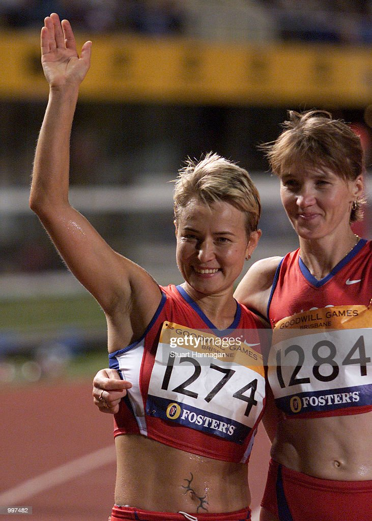 Olimpiada Ivanova of Russia (left) celebrates with Silver medalist Yelena Nikolayeva of Russia after setting a New World Record of 1:26:52.3 in the Womens 20000 Metres Track Walk during the athletics at the ANZ Stadium during the Goodwill Games in Brisbane, Australia. DIGITAL IMAGE Mandatory Credit: Stuart Hannagan/ALLSPORT