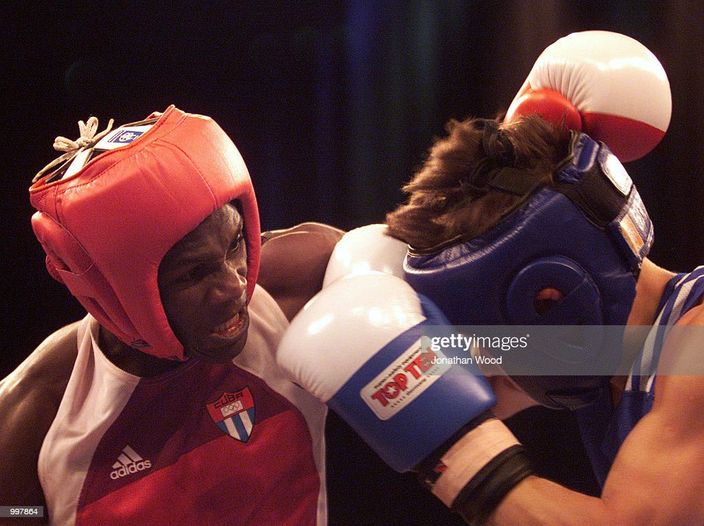Osvaldo Liranza of Cuba delivers a blow to his opponent Georgi Balakshin of Russia during the 51kg Gold Medal bout held at the South Bank Convention Centre, Brisbane, Australia. DIGITAL IMAGE. Mandatory Credit: Jonathan Wood/ALLSPORT