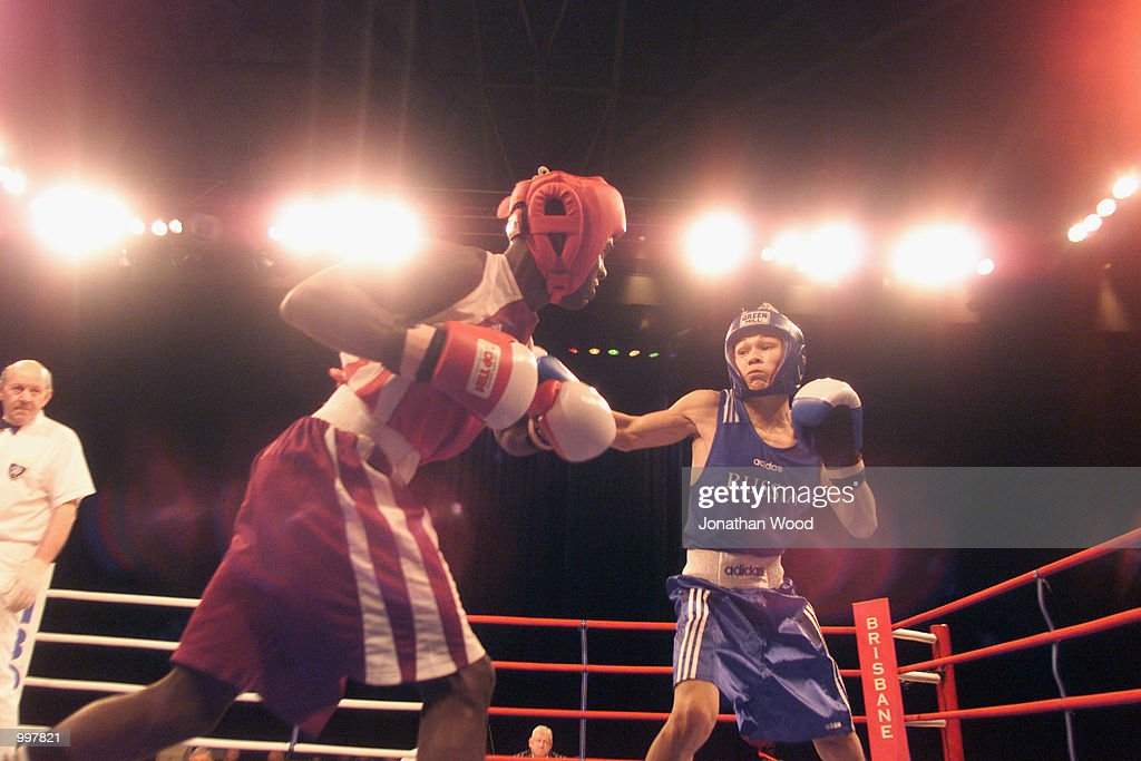 Osvaldo Liranza of Cuba exchanges blows with his opponent Georgi Balakshin of Russia during the 51kg Gold Medal bout held at the South Bank Convention Centre, Brisbane, Australia. DIGITAL IMAGE. Mandatory Credit: Jonathan Wood/ALLSPORT