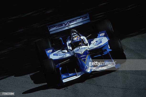 Patrick Carpentier of Canada who drives the Ford Reynard for Player's Forsythe Racing driving on the track during the Molson Indy part of the CART...