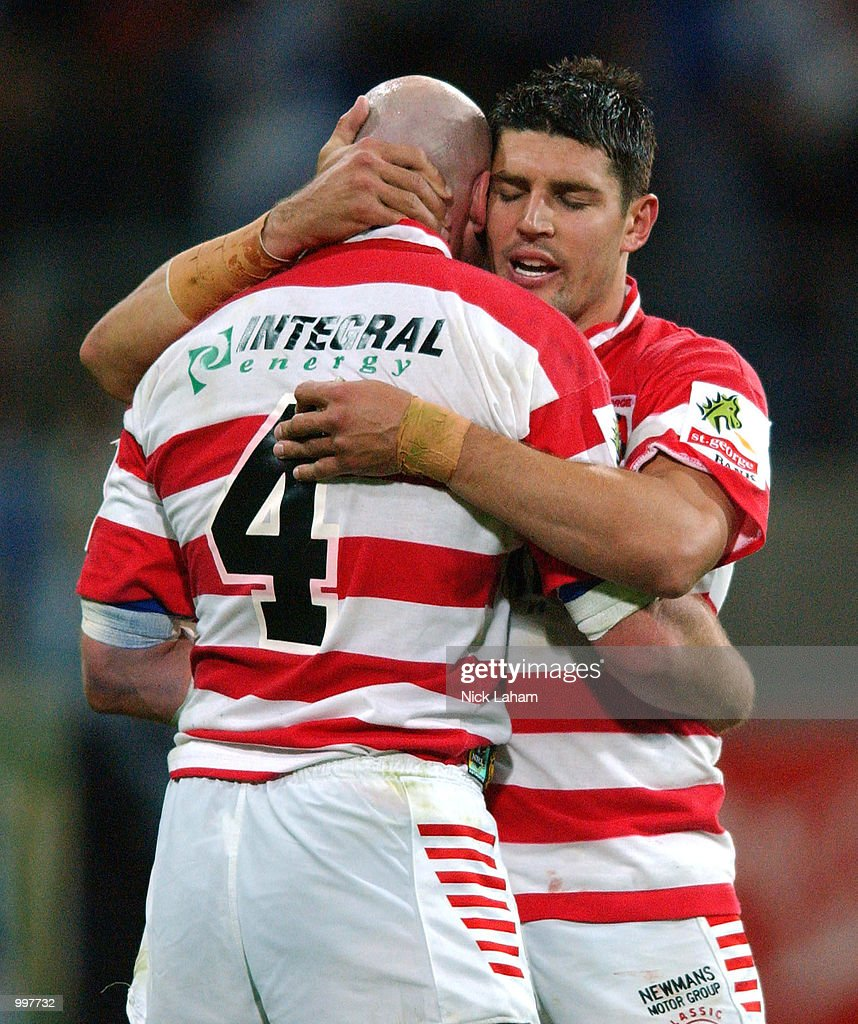 Paul McGregor #4 and Trent Barrett #6 of the Dragons embrace after their victory in the NRL qualifying final between the Bulldogs and the St George Illawarra Dragons held at the Sydney Showground, Homebush Bay, Sydney, Australia. The Dragonsdefeated the Bulldogs 23-22. DIGITAL IMAGE Mandatory Credit: Nick Laham/ALLSPORT