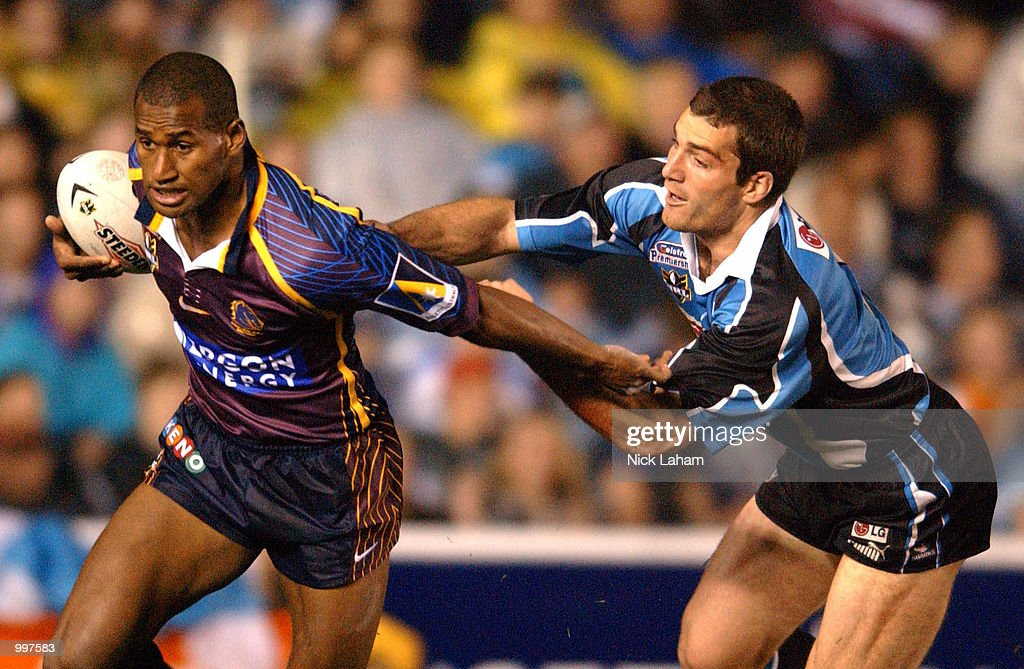 Paul Mellor #3 of the Sharks attempts to stop Lote Tuqiri #2 of the Broncos during the NRL qualifying final between the Sharks and the Brisbane Broncos held at Toyota Park, Sydney, Australia. DIGITAL IMAGE Mandatory Credit: Nick Laham/ALLSPORT