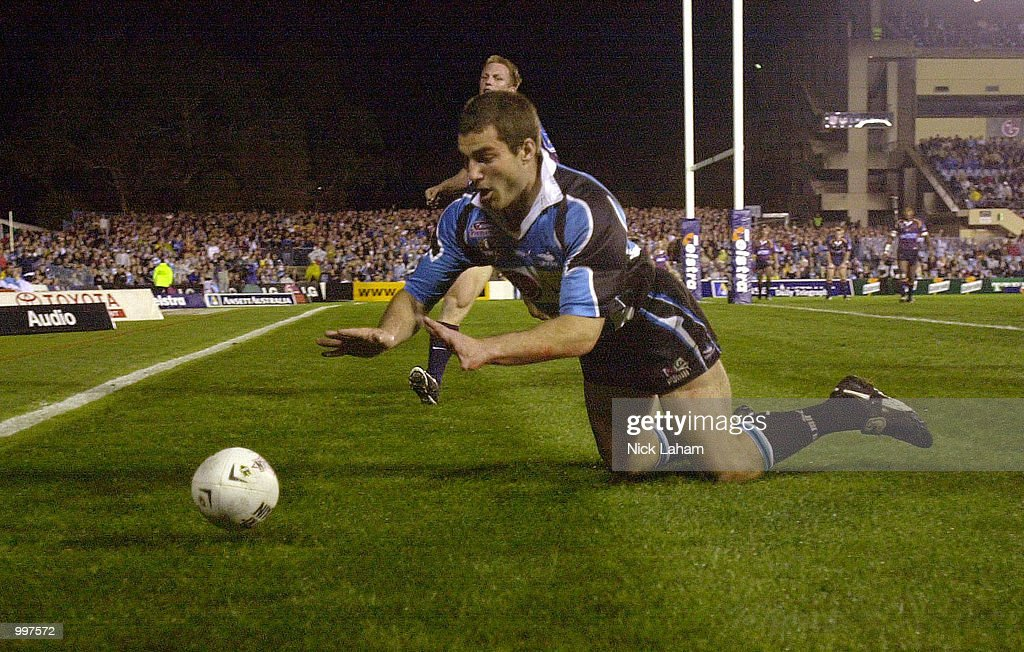 Paul Mellor #3 of the Sharks dives for a try during the NRL qualifying final between the Sharks and the Brisbane Broncos held at Toyota Park, Sydney, Australia. DIGITAL IMAGE Mandatory Credit: Nick Laham/ALLSPORT