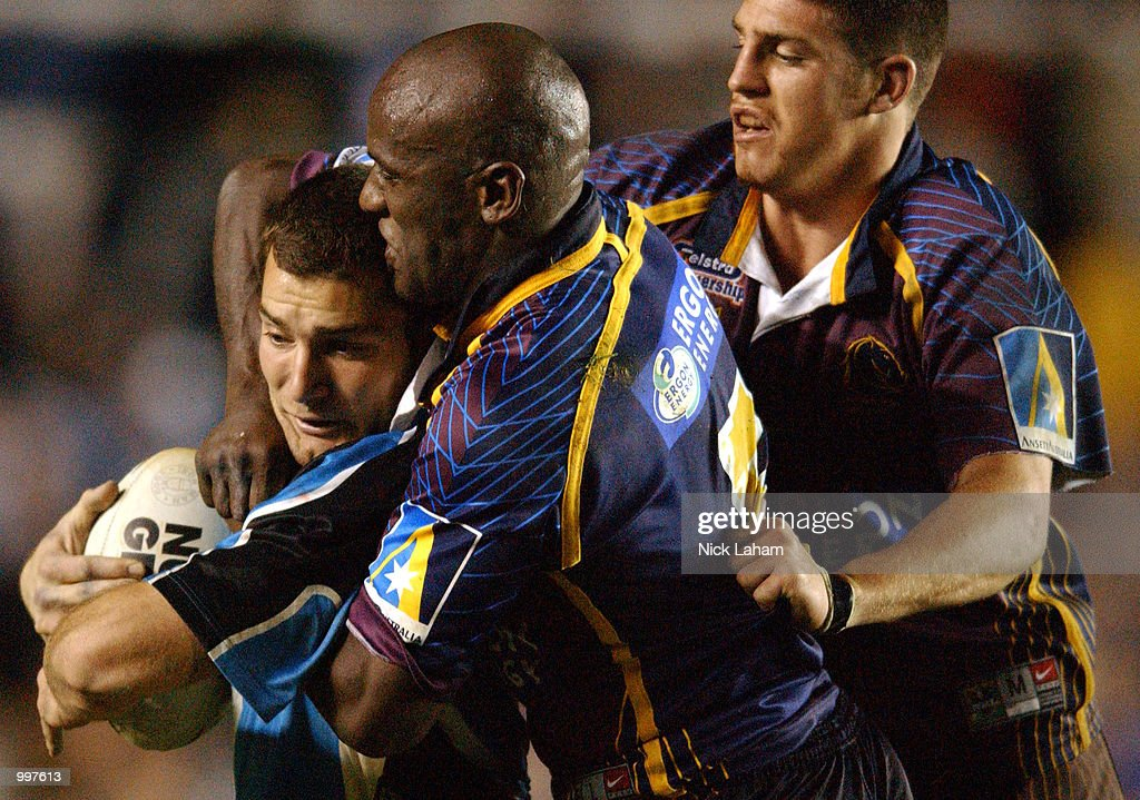 Paul Mellor #3 of the Sharks is wrapped up by Wendell Sailor #5 and Luke Priddis #9 of the Broncos during the NRL qualifying final between the Sharks and the Brisbane Broncos held at Toyota Park, Sydney, Australia. DIGITAL IMAGE Mandatory Credit: Nick Laham/ALLSPORT