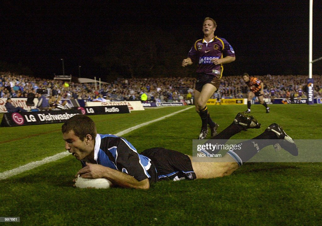 Paul Mellor #3 of the Sharks scores a try as Darren Lockyer #1 of the Broncos watches on during the NRL qualifying final between the Sharks and the Brisbane Broncos held at Toyota Park, Sydney, Australia. DIGITAL IMAGE Mandatory Credit: Nick Laham/ALLSPORT