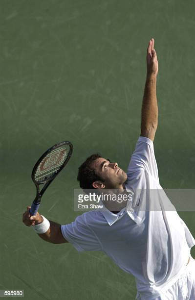 Pete Sampras of the USA serves to Marat Safin of Russia during the semifinals of the US Open at the USTA National Tennis Center in Flushing New York...