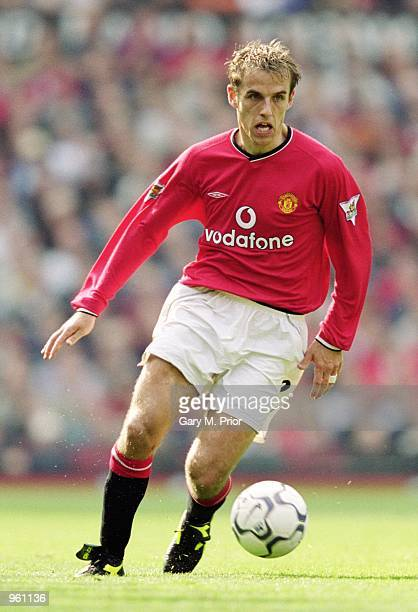 Phil Neville of Man Utd on the ball during the FA Barclaycard Premiership match between Manchester United and Ipswich Town played at Old Trafford in...