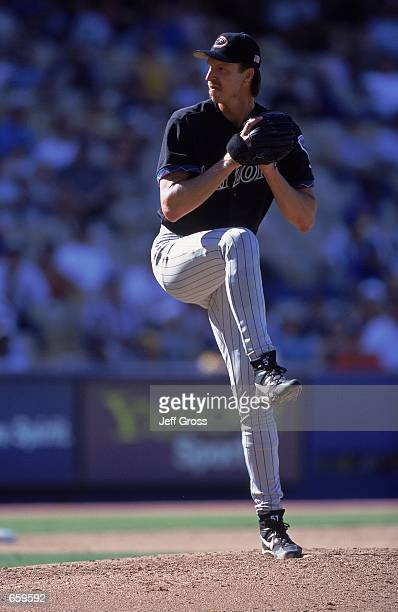 Pitcher Randy Johnson of the Arizona Diamondbacks winding up for a pitch during the game against the Los Angeles Dodgers at Dodger Stadium in Los...