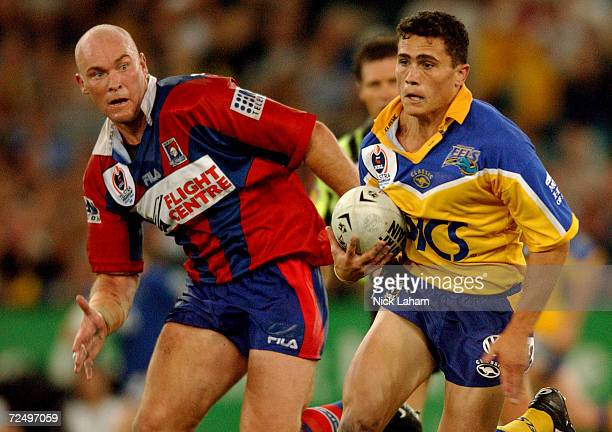 PJ Marsh of the Eels steps past Ben Kennedy of the Knights during the NRL Grand Final between the Parramatta Eels and the Newcastle Knights held at...