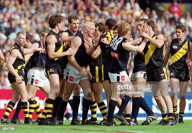 Players from Carlton and Richmond teams are involved in a melee during the AFL Semi Final match played between the Richmond Tigers and the Carlton...
