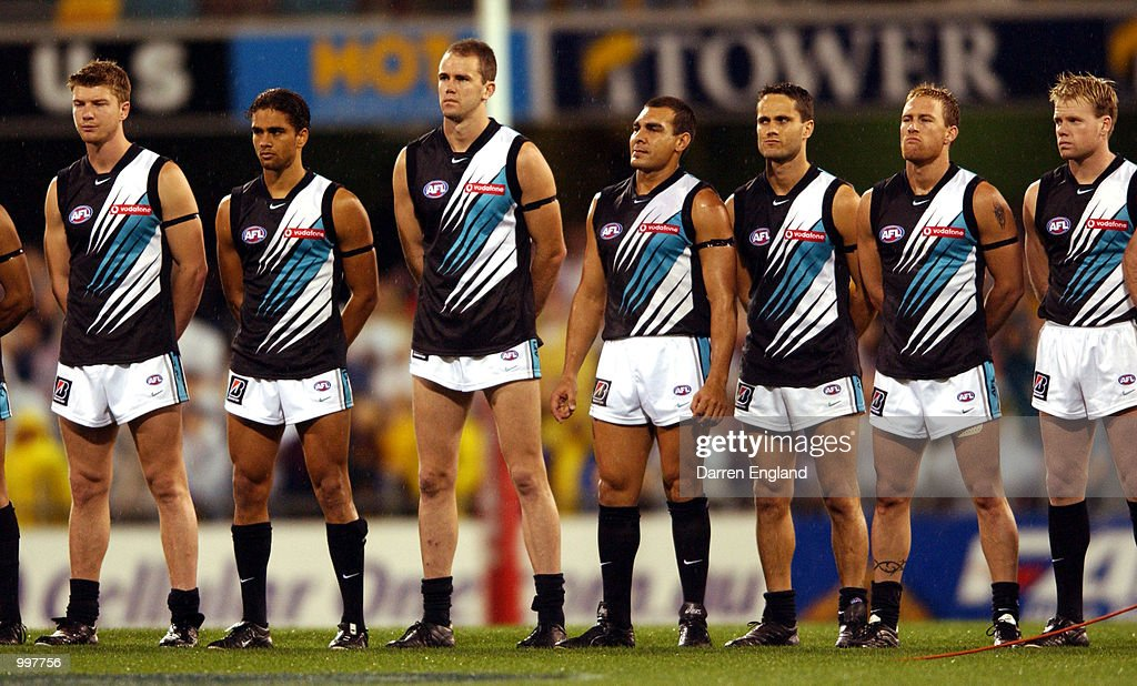 Port Adelaide players line up for the national anthem before the AFL Qualifying final match between the Brisbane Lions and the Port Adelaide Power played at the Gabba in Brisbane, Australia. DIGITAL IMAGE. Mandatory Credit: Darren England/ALLSPORT