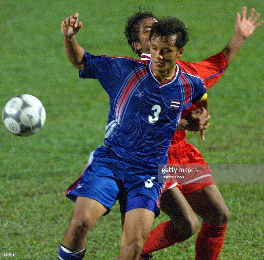 Preratat Phoruandee of Thailand is checked by Phengta Phounsamay of Laos in a Group A match held at the MPPJ Stadium, Petaling Jaya, Malaysia during the Under-23 Men Football Tournament of the 21st South East Asian Games. DIGITAL IMAGE. Mandatory Credit: Stanley Chou/ALLSPORT