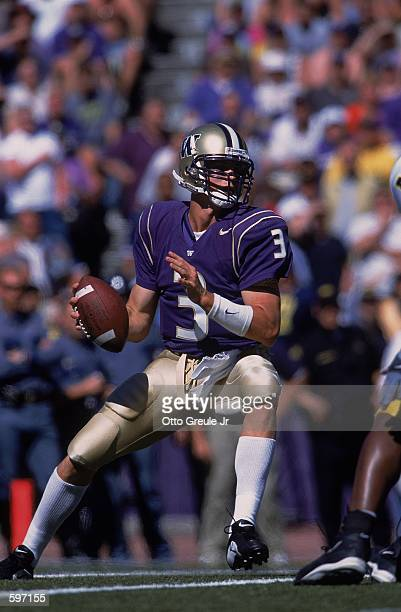 Quarterback Cody Pickett of the Washington Huskies looking to pass the ball during the game against the Michigan Wolverines at the Husky Stadium in...