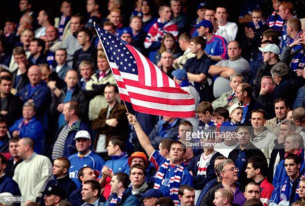 Rangers fan waves the USA Flag during the Tennants Scottish Premier League match between Glasgow Rangers and Celtic played at Ibrox in Glasgow...