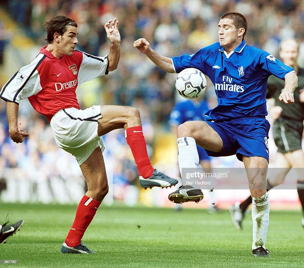 Robert Pires of Arsenal challenges Frank Lampard of Chelsea during the FA Barclaycard Premiership match between Chelsea and Arsenal at Stamford Bridge, London. Mandatory Credit: Ben Radford/ALLSPORT