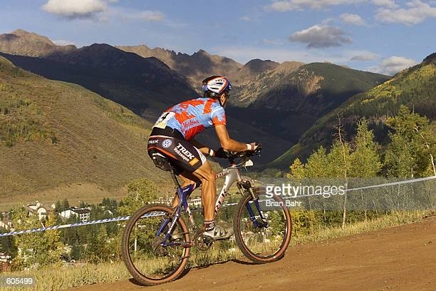 Roland Green of Canada heads up the mountain with the Gore Range in the background en route to a gold medal during the cross country competition of...