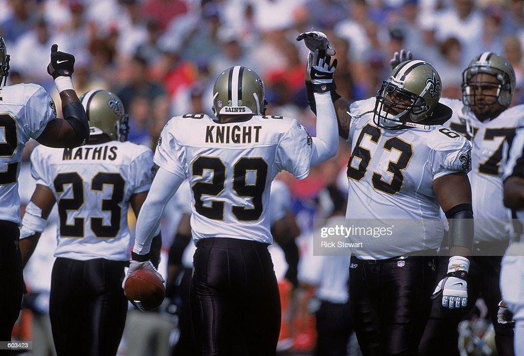 Sammy Knight #29, Jerry Fontenot #62 : News Photo