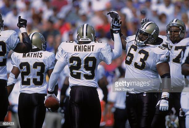 Sammy Knight of the New Orleans Saints celebrates with Wally Williams after catching 1 of 3 interceptions during the game against the Buffalo Bills...