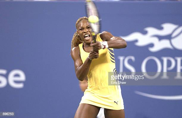 Serena Williams of the USA returns a shot to Lindsay Davenport of the USA during their quarterfinals match in the US Open at USTA National Tennis...