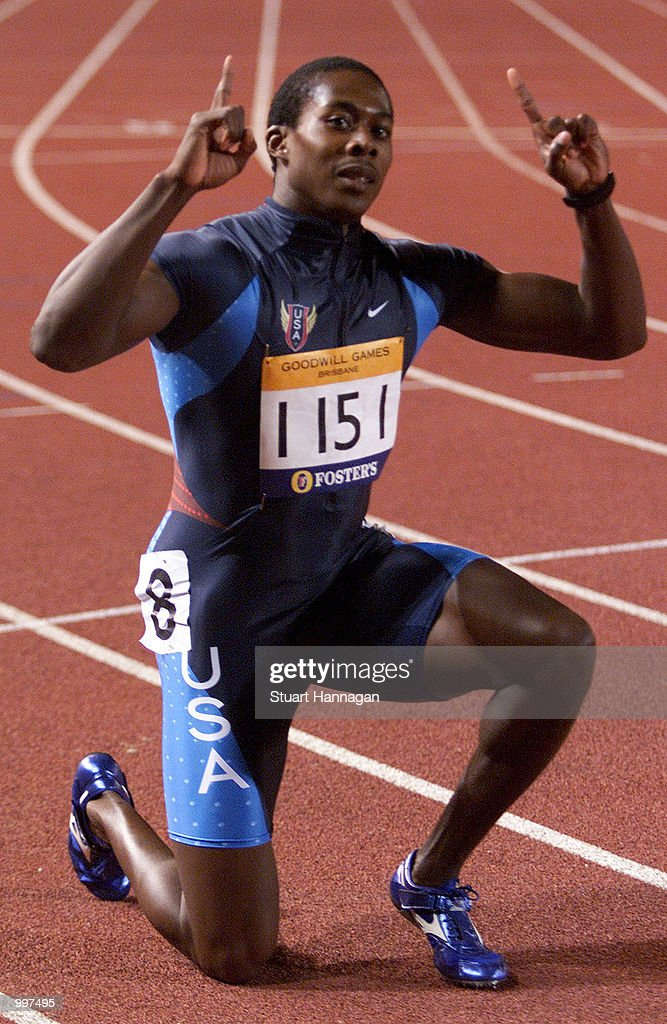 Shawn Crawford of the USA celebrates victory in the Mens 200 Metres with a time of 20.17 seconds during the athletics at the ANZ Stadium during the Goodwill Games in Brisbane, Australia. DIGITAL IMAGE Mandatory Credit: Stuart Hannagan/ALLSPORT