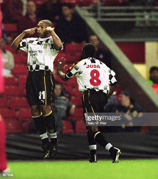 Silva of Boavista celebrates opening the scoring during the UEFA Champions League Group B match against Liverpool played at Anfield in Liverpool...
