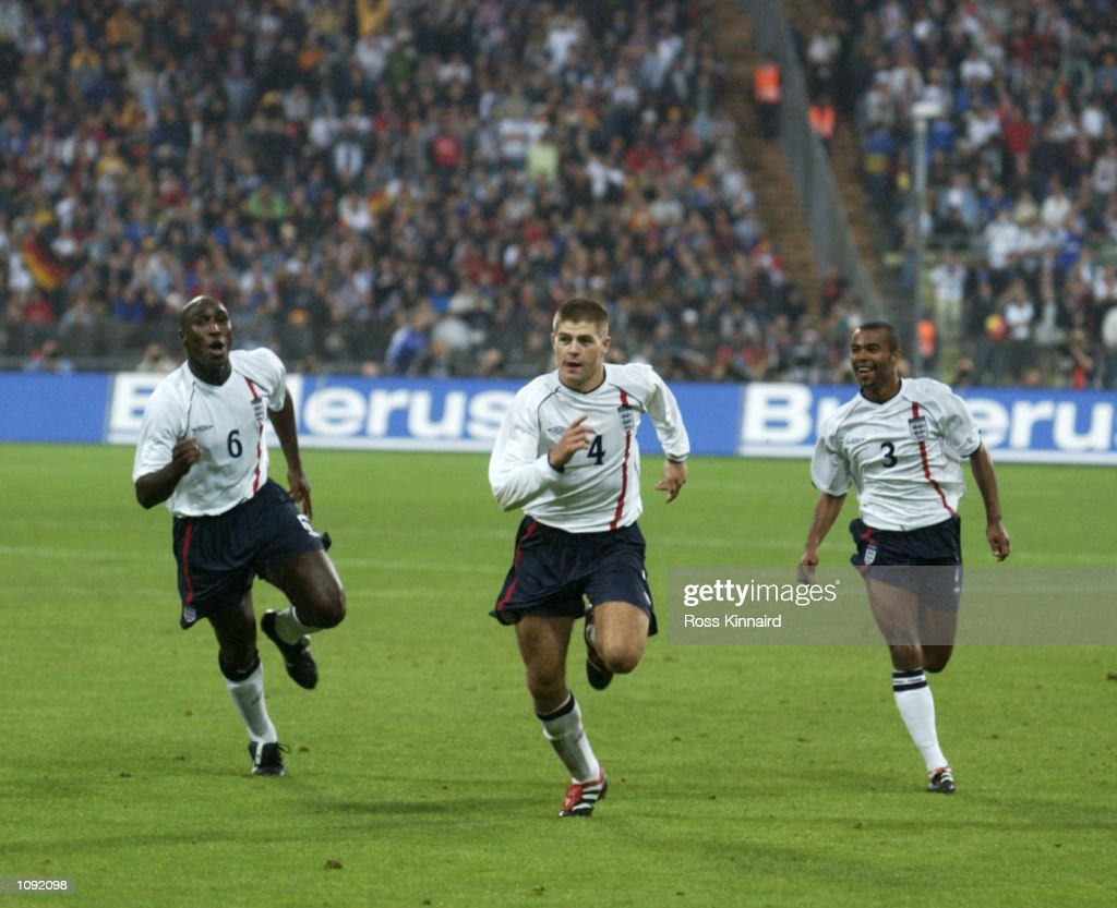 Sol Campbell, Steven Gerrard, and Ashley Cole of England celebrate Gerrard's goal during the FIFA World Cup 2002 Group Nine Qualifying match against Germany played at the Olympic Stadium, in Munich, Germany. England wonthe match 5-1. DIGITAL IMAGE. Mandatory Credit: Ross Kinnaird/Getty Images