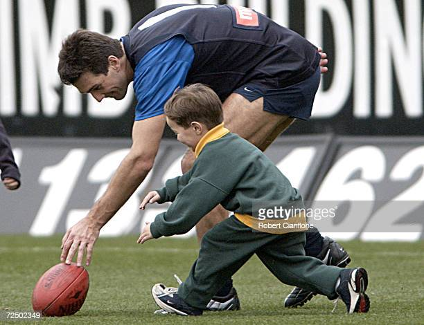 Stephen Silvagni of Carlton plays with his son Jack after todays training session as Carlton prepare to play Richmond in the AFL Semi Final on...