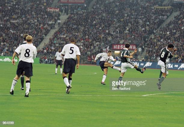 Steven Gerrard of England shoots to score England's 2nd goal during the FIFA 2002 World Cup Qualifier against Germany played at the Olympic Stadium...