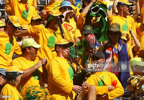 The Australian Fanatics cheer on Todd Woodbridge and Wayne Arthurs of Australia in their match against Magnus Larsson and Jonas Bjorkman of Sweden in...