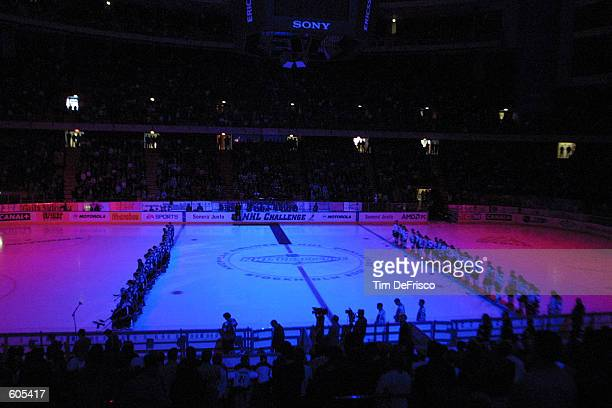 The Colorado Avalanche left and Brynas of the Swedish Hockey League along with all the fans bow their heads in a moment of silence honoring the...