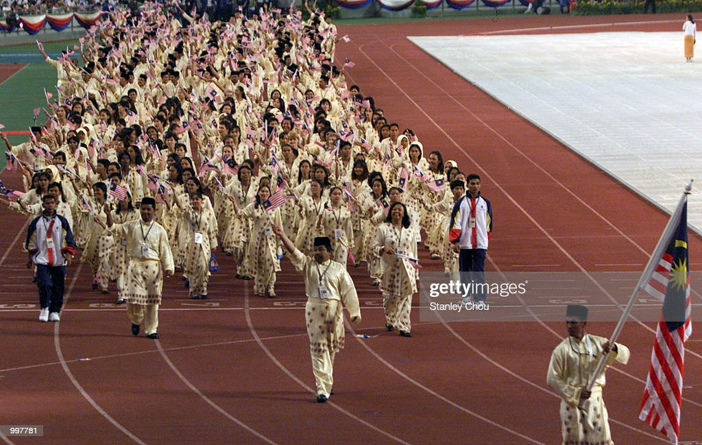 The Malaysian Contigent marching in during the Opening Ceremony held at the Bukit Jalil National Stadium, Kuala Lumpur, Malaysia during the 21st South East Asian Games. DIGITAL IMAGE. Mandatory Credit: Stanley Chou/ALLSPORT