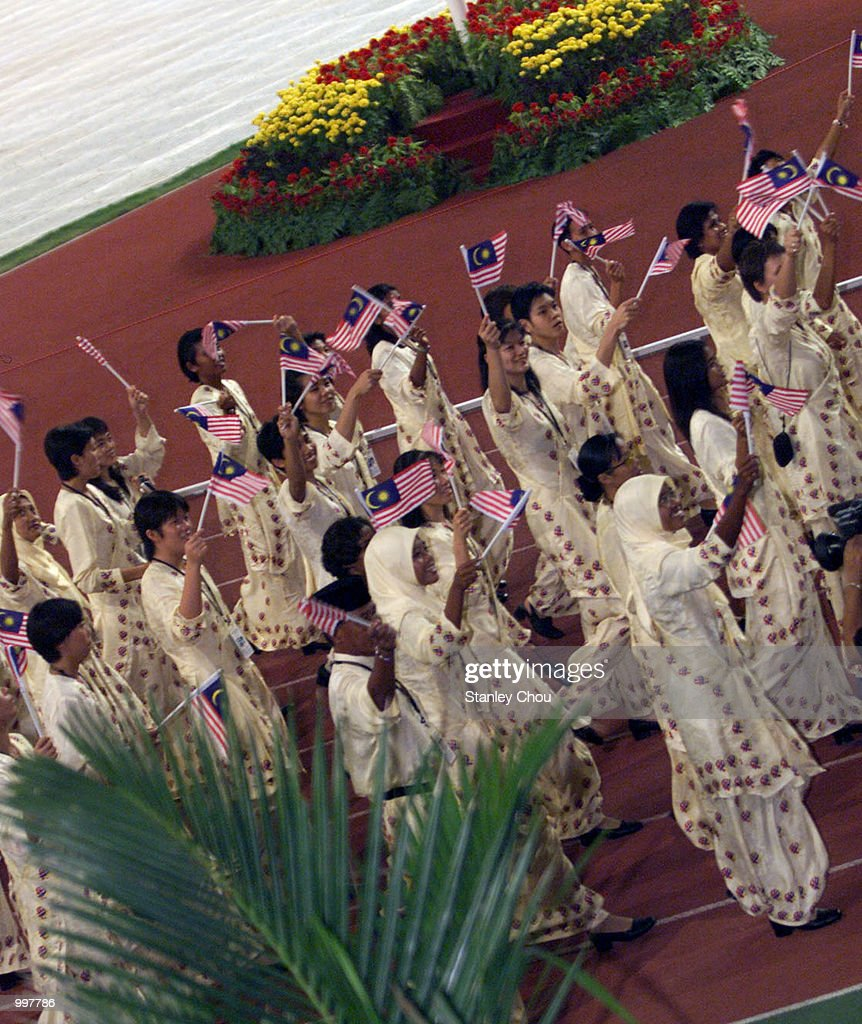 The Malaysian Female Contigent marching in during the Opening Ceremony held at the Bukit Jalil National Stadium, Kuala Lumpur, Malaysia during the 21st South East Asian Games. DIGITAL IMAGE. Mandatory Credit: Stanley Chou/ALLSPORT