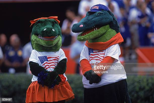 The Mascots for the Florida Gators wear patriotic tshirts during the game against the Mississippi State Bulldogs in Gainesville Florida The Gators...