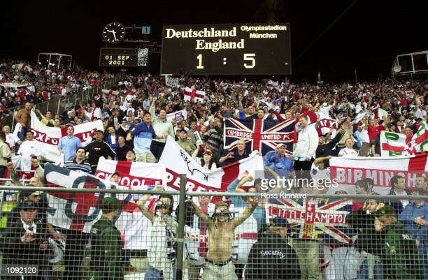 The scoreboard tells the story as England fans celebrate a proud day after the FIFA World Cup 2002 Group Nine Qualifying match against Germany played...