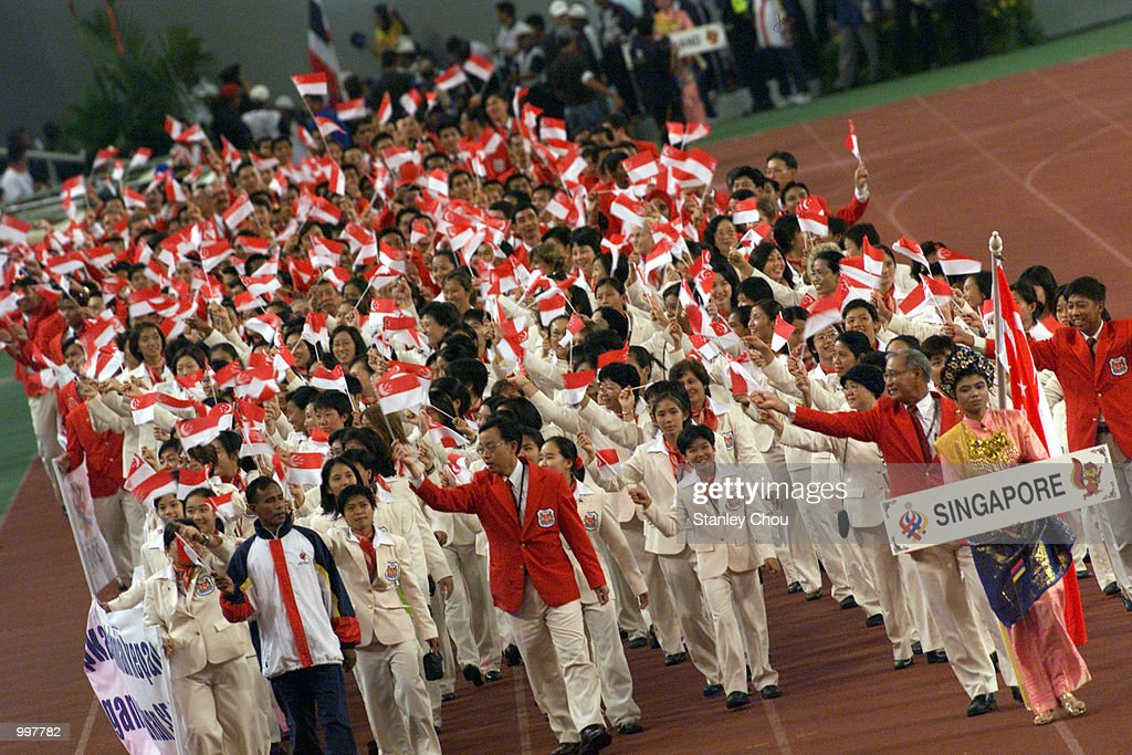The Singapore Contigent marching in during the Opening Ceremony held at the Bukit Jalil National Stadium, Kuala Lumpur, Malaysia during the 21st South East Asian Games. DIGITAL IMAGE. Mandatory Credit: Stanley Chou/ALLSPORT
